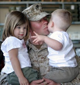 Soldier with children, getting ready for military moving.