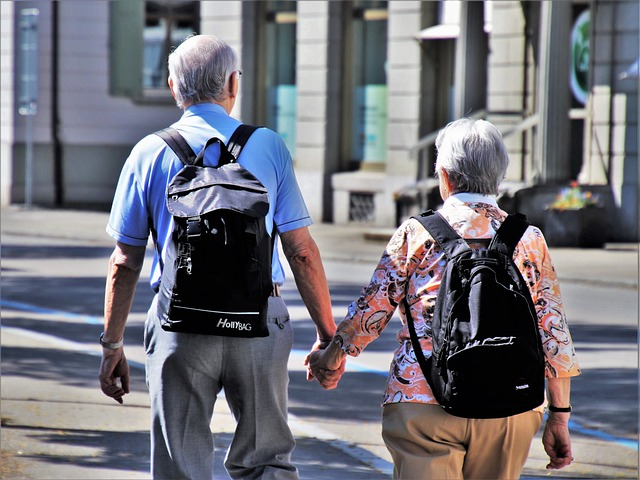 Two seniors holding hands and moving