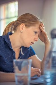 woman stressing out because she hired a fraudulent mover
