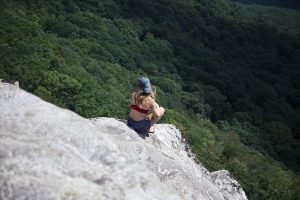 a girl sitting on a clif in South Carolina