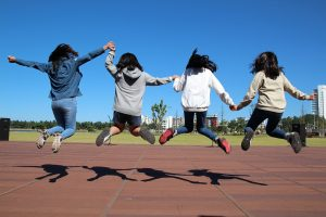 Four girls jump