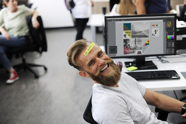 An employer feeling happy after setting up a new office