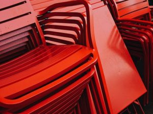 red chairs stacked one upon other