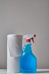 use spray and tissues for cleaning your office as a part of office decluttering guidelines