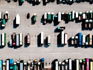 Many trucks parked on a parking lot seen from above