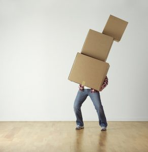 A man holding boxes