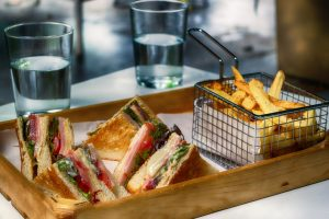 Sandwiches and fries served on a platter.