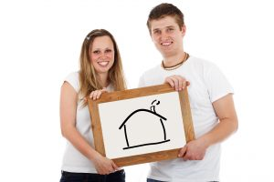 couple holding a house painting