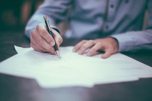 Signing a moving contract or paperwork