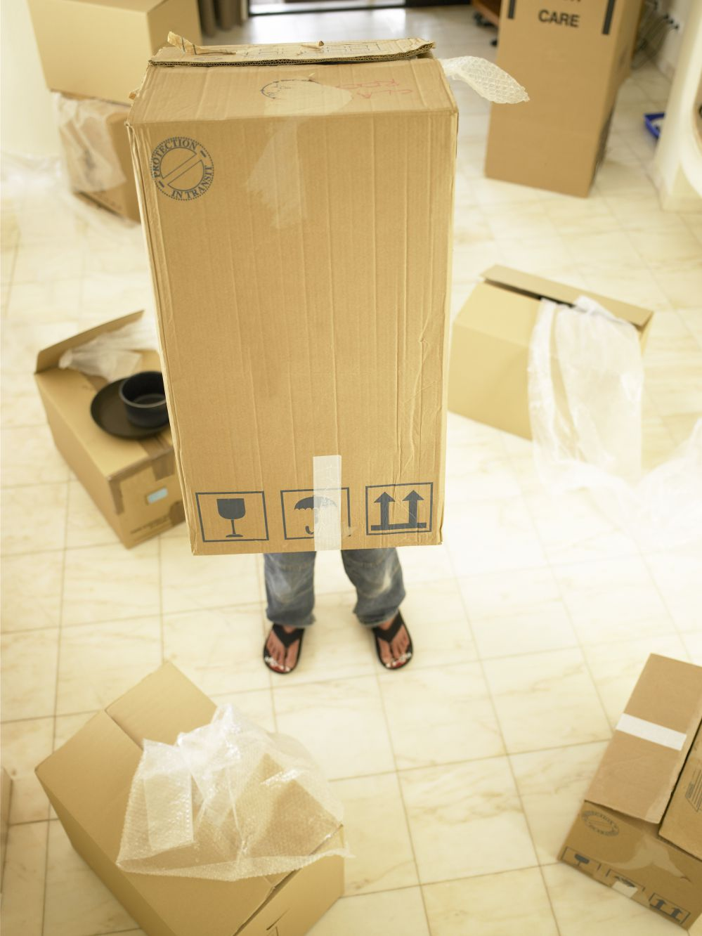 a kid with moving boxes
