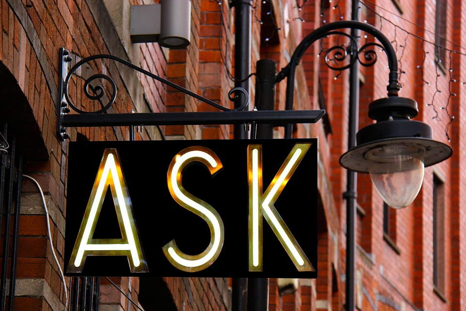 A hanging ask sign.