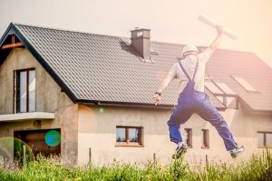 Man jumping in front of a house