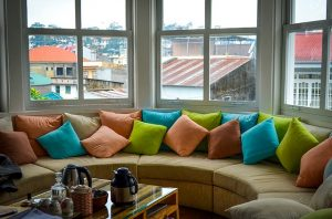 Colorful pillows under a window