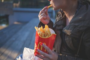 Woman eating fries during a move