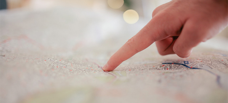 A person pointing to a map