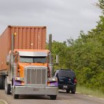 A truck that is carrying container as one of the things to know about moving containers